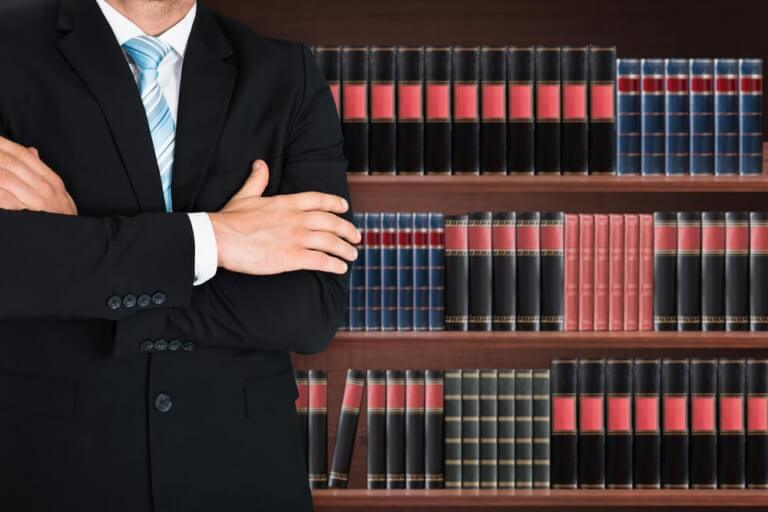 Man standing in front of bookcase