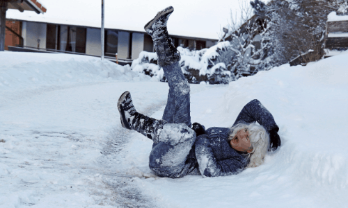Woman Falling on Snow - Slip and Fall